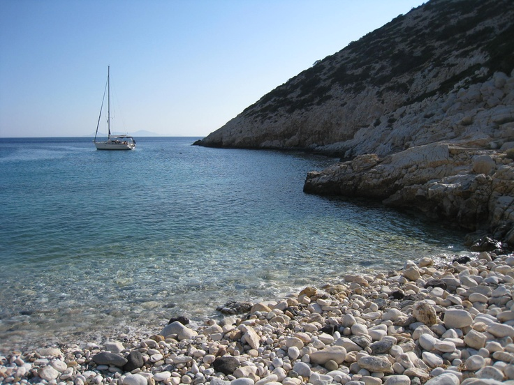 The marble stone beach in a pretty anchorage. Dhinoussa, Cyclades Islands. Greece