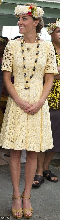 'INDEPENDENT DRESS-MAKER': On the last day of their tour, the Duchess wore this yellow dress with flower eyelets with her Stuart Weitzman wedges