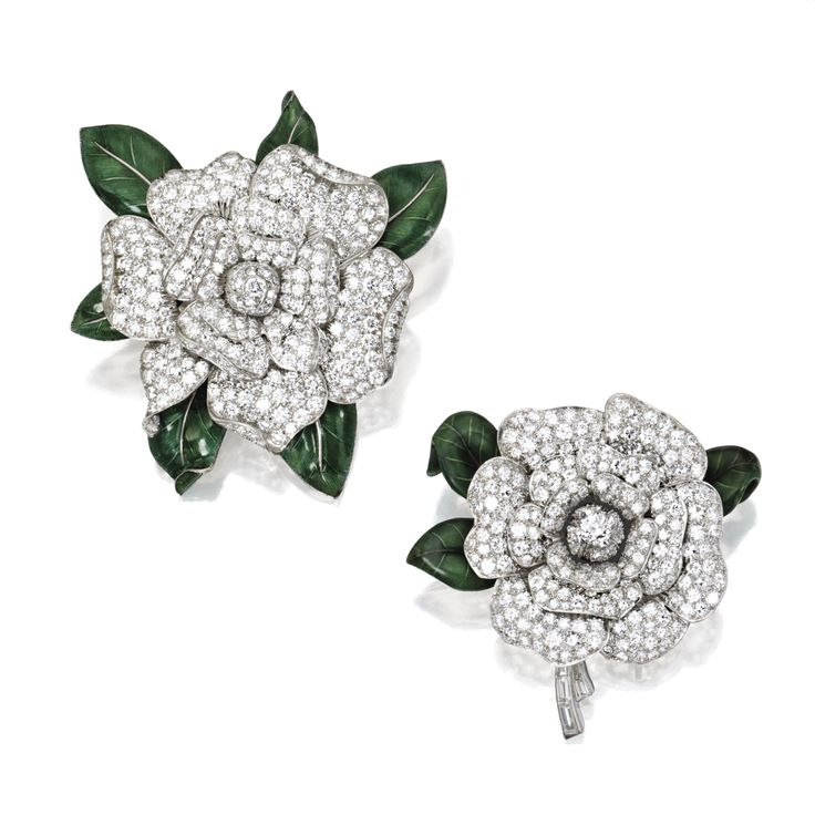 TWO PLATINUM, 18 KARAT WHITE GOLD, DIAMOND AND ENAMEL GARDENIA BROOCHES, ONE BY OSCAR HEYMAN & BROTHERS, 1994 The larger blossom pavé-set with round diamonds weighing 10.21 carats, the leaves applied with dark green enamel, maker's mark for Oscar Heyman & Brothers, numbered 74591; the smaller blossom pavé-set with round, baguette and old European-cut diamonds weighing approximately 7.40 carats, the leaves applied with dark green enamel.