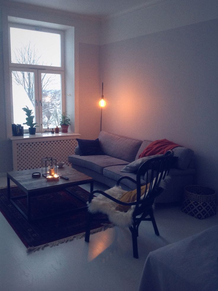 My Livingroom. Warm colours , rug, candles , plants