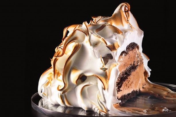 Chocolate ice-cream in an oven? If it's bundled up in a thick layer of meringue, the outside caramelises and inside remains brilliantly chilly.