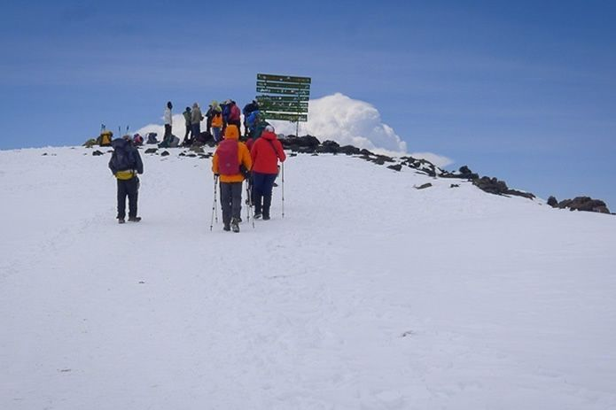 Soaring above Climb Mount Kilimanjaro, Africa's highest peak is 5896 meters above sea level. This incredible equatorial mountain, capped with snow