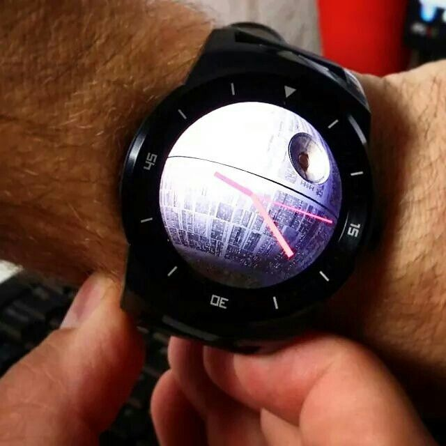 It's no moon! LG G Watch R sporting a nice background image.