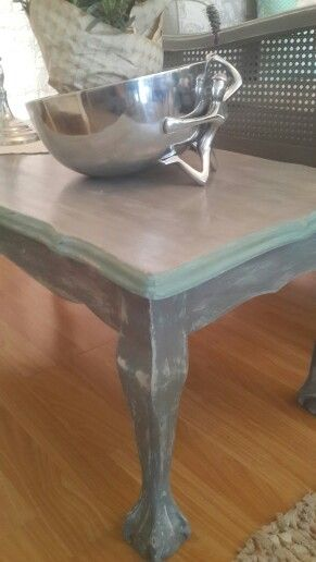 Annie Sloan Chalk Paint. 1st coat Pure white. Second coat Provence on legs. Legs and table top mixture of Paris Grey and Graphite. Sanded and then clear wax.