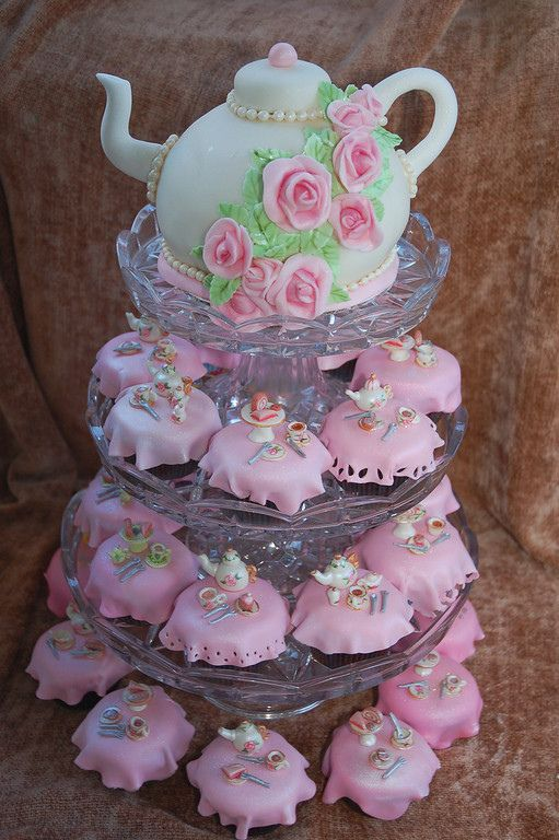 My daughter asked for a Mermaid Tea Party party for her 6th birthday.  Much of the decor for tomorrow's party will be under-the-sea, and the cookies are all mermaids and sea-life, but the cake is all tea party.  I got the idea for the miniature tea set cupcakes from Zalita on flickr.  Her work is absolutely exquisite.