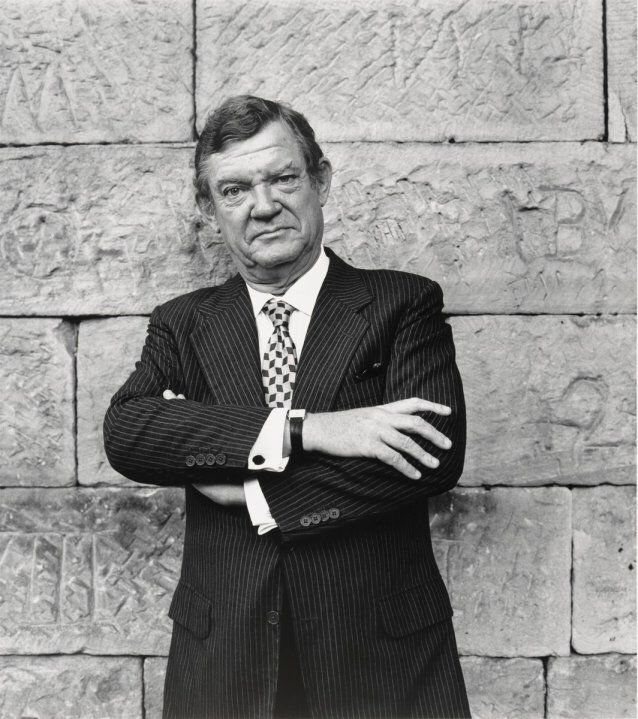 Photographer: Rex Dupain Title: Robert Hughes Date: 1996 Size: 42.9 x 37.8cm Medium: Gelatin Silver Photograph  URL: http://www.portrait.gov.au/portraits/1999.26/robert-hughes  This image is of a man whose facial expression looks sort of angry and unhappy. The mood of the picture is angry and annoyed.  This is because of his facial expression and also how the picture is black and white, having no colour makes the picture a lot more sad like.