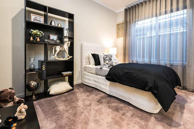 This homely bedroom is both restful and comfortable. #weeksbuildinggroup #newhome #homedesign