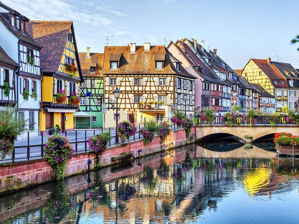 Colmar France building water outdoor Canal Town geographical feature landform body of water waterway cityscape neighbourhood human settlement scene house River vacation tourism Harbor Village flower several