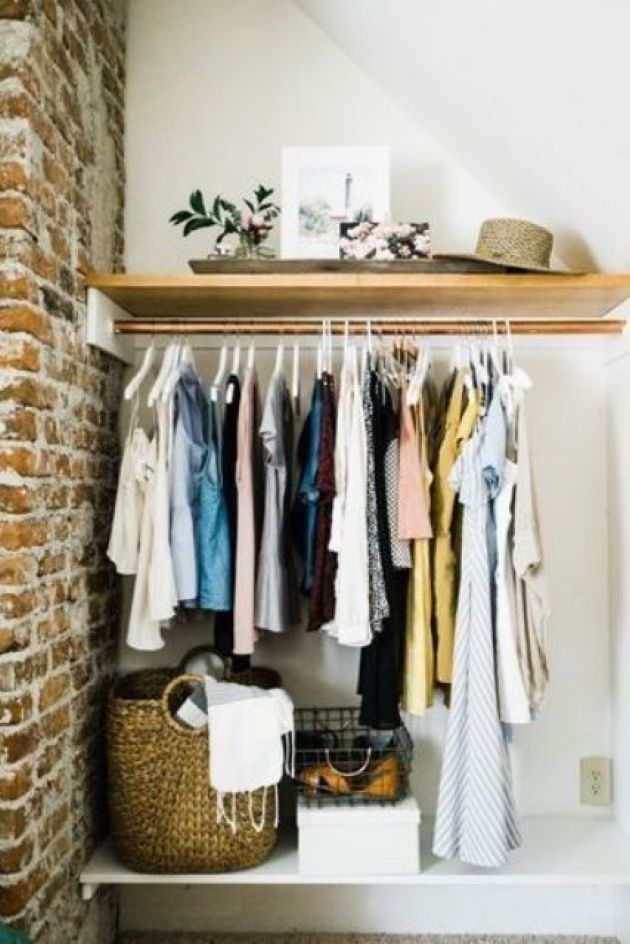 Open Closet In The Corner With A Holder For Hangers And An Open