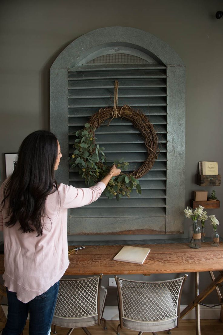 simple grapevine wreaths, filled them with fresh and faux greenery. When making your own wreath, you can use fresh greenery that will dry pretty, like seeded eucalyptus, or faux greenery, like these olive stems