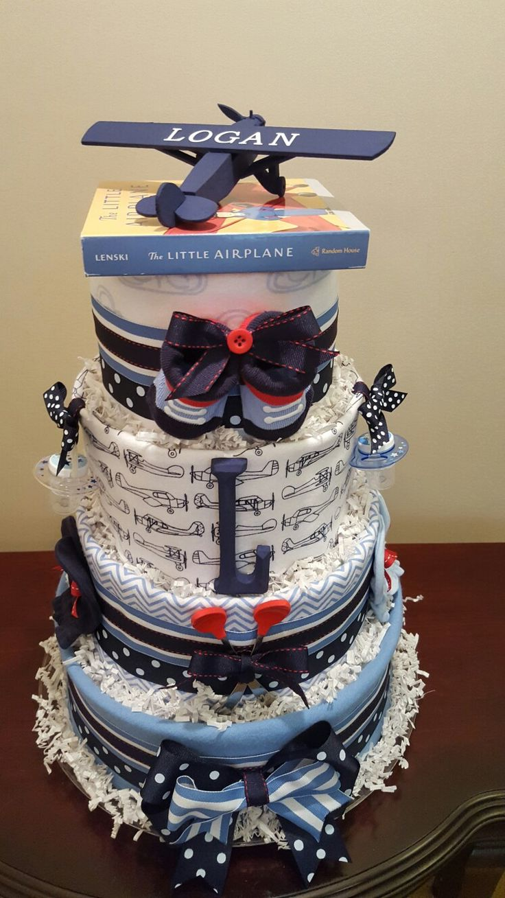 Airplane baby boy diaper cake. Perfect centerpiece for your baby shower.  Check out my Facebook page Simply Showers for more pics and orders.  https://m.facebook.com/adorablegifts