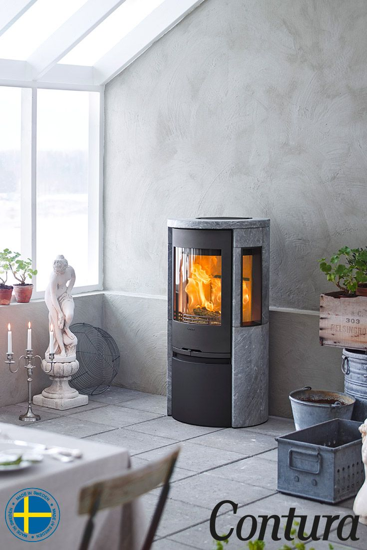 Contura 556T Style with cast iron door is a soapstone stove with large sidelights that show a lot of the fire. #conservatory #concrete #diningtable