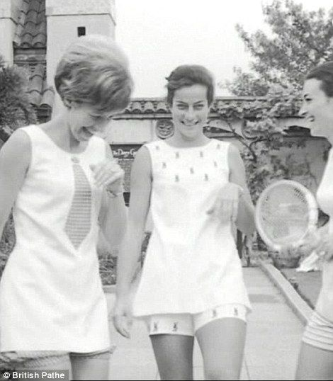 Virginia Wade, centre, tries out a Tinling dress for size