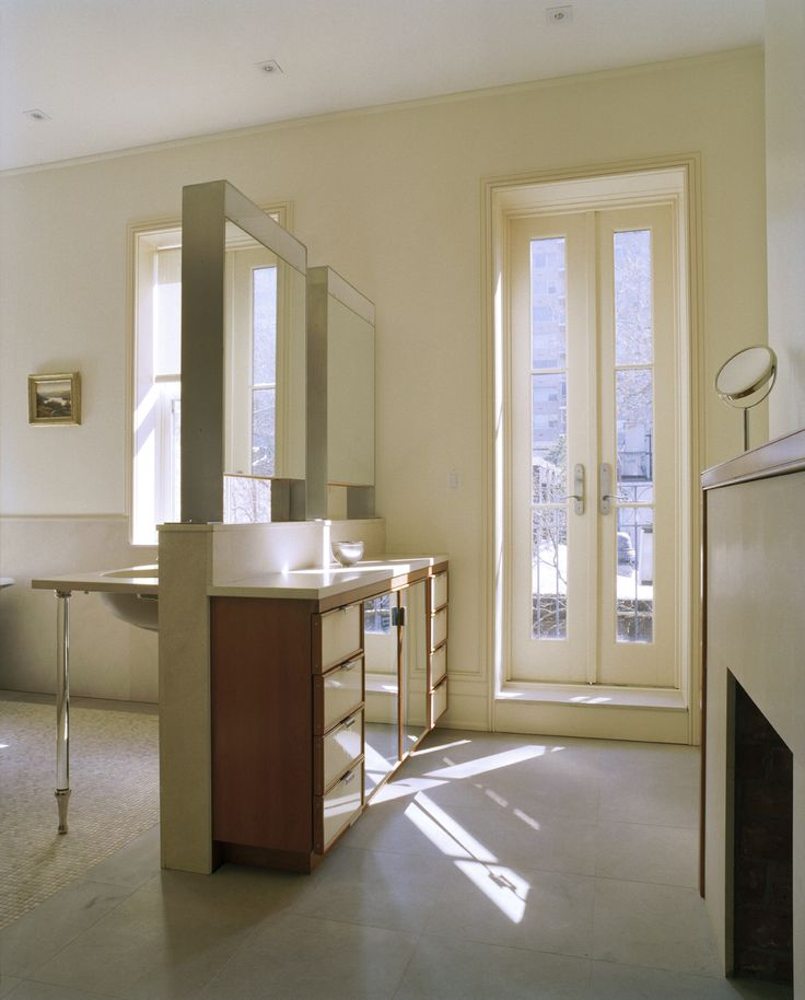 Master bathroom, custom medicine cabinet mirrored on both sides. Custom built in console.