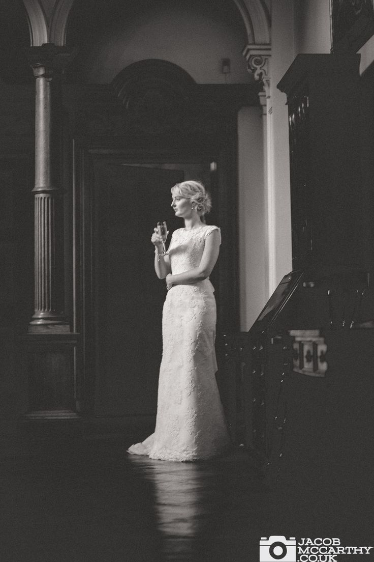 A dramatic photograph of the bride at Orchardleigh House. Fashion inspired wedding photography by Jacob McCarthy. See more bridal photography and other work at www.jacobmccarthy.co.uk
