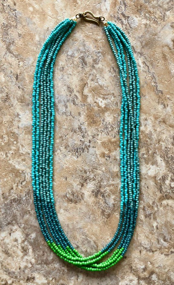 Six Strand Necklace Is Made Of Green Blue And Turquoise Seed Beads And Finished With An Antique Gold Beaded Necklace Beaded Jewelry Jewelry Making Necklace