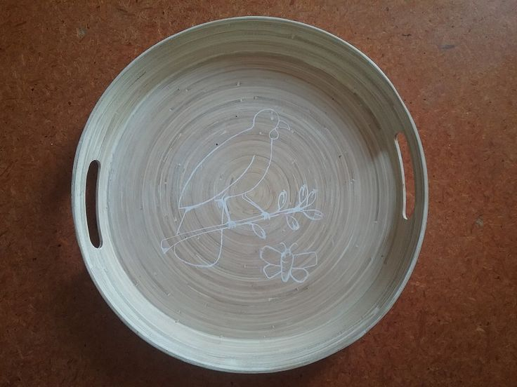 Cheap bamboo serving dish, embellished with a white screenprinted kokako in some harakeke (with a harakeke moth for company). The result of playing with the new thermal printer in the art room.