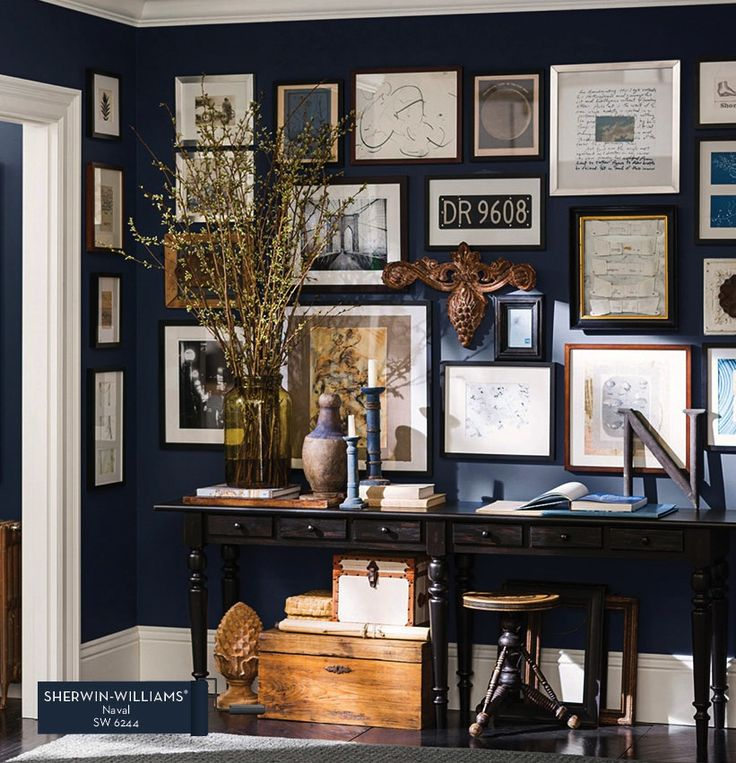 Pottery Barn Sherwin-Williams Paint Collection - shown with navy wall in home office. Think it's absolutely stunning! Love the collection of artwork, etc. on the wall - just right!