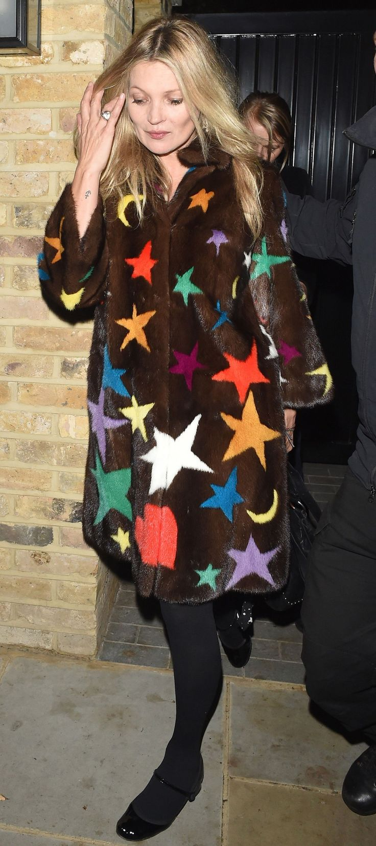 Kate Moss debuts what may be her best statement coat yet.