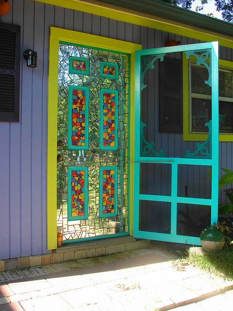 This looks like fun!  A mirrored mosaic.I could see this on a garden shed door, reflecting back the vegetables or blooms and topiary. INTERESTING idea. On a house front door? 0_0 nope.