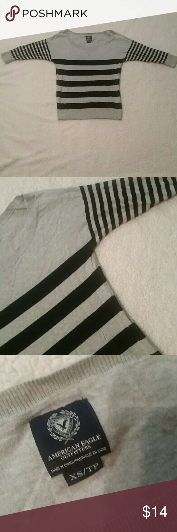 3/4 sleeve American Eagle shirt Gray and black striped American Eagle shirt. 3/4 length sleeves. XS but fits like a small. American Eagle Outfitters Tops