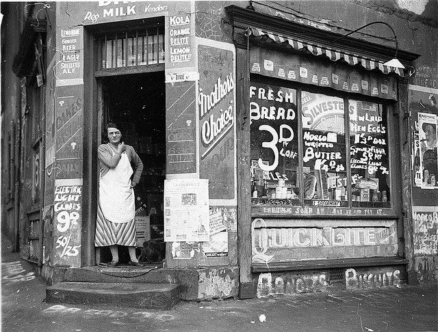 "Depression ""bread wars"", corner store on Bourke & Fitzroy Streets, Surry Hills, Sydney, 21 August 1934 / Sam Hood. The shop still stands, worn step included, but the area has gentrified since its slum days. From the collections of the Mitchell Library, State Library of New South Wales www.sl.nsw.gov.au Find out more about this photograph: http://acms.sl.nsw.gov.au/item/itemDetailPaged.aspx?itemID=52316"