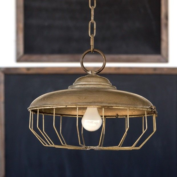 Chicken feeder pendant light has the appearance of a repurposed chicken feeder visit antique farmhouse for more hanging lights