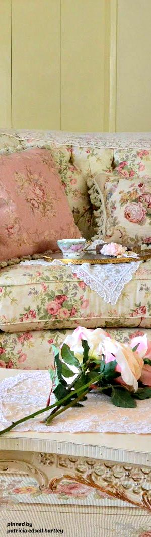 Tea in the English shabby sitting room. I'd like to see the wall paint whiter; it would show off the floral fabrics - including the rug - much better.