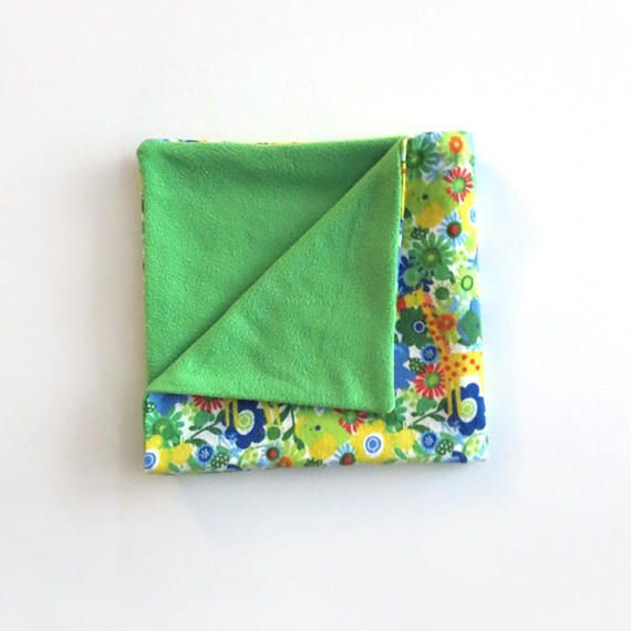 This cozy baby blanket is perfect for your little one. It is made with a soft flannel front and backed with fleece. This blanket makes a great baby shower gift! #babyblanket #babyshowergifts