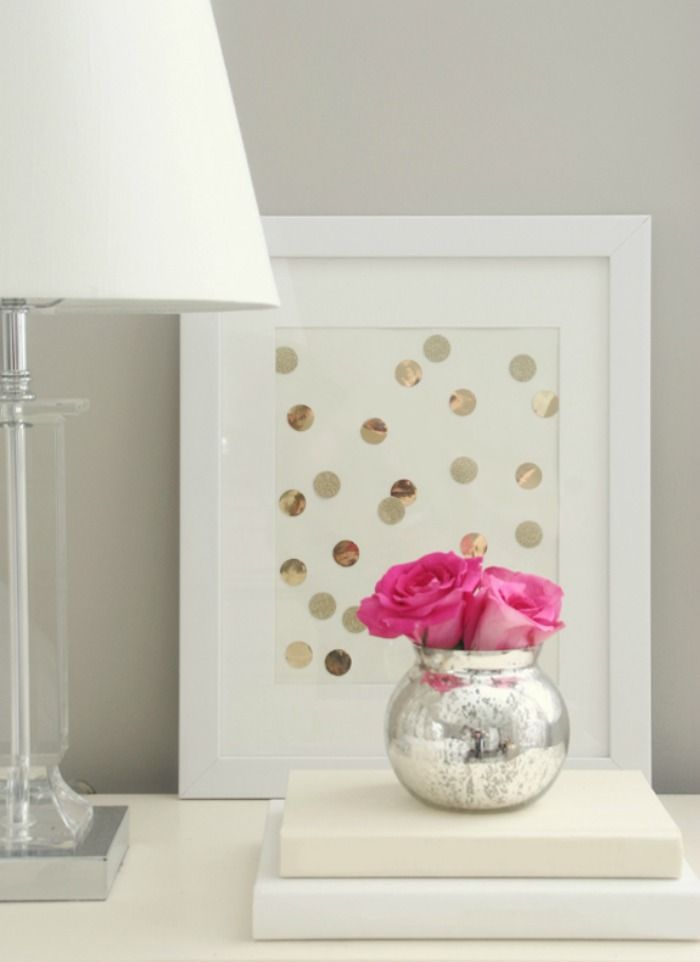 Kate Spade Inspired: foil paper circles arranged in frame; simple mercury vase holding bright colored flowers
