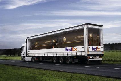 FedEx transporting UPS trucks