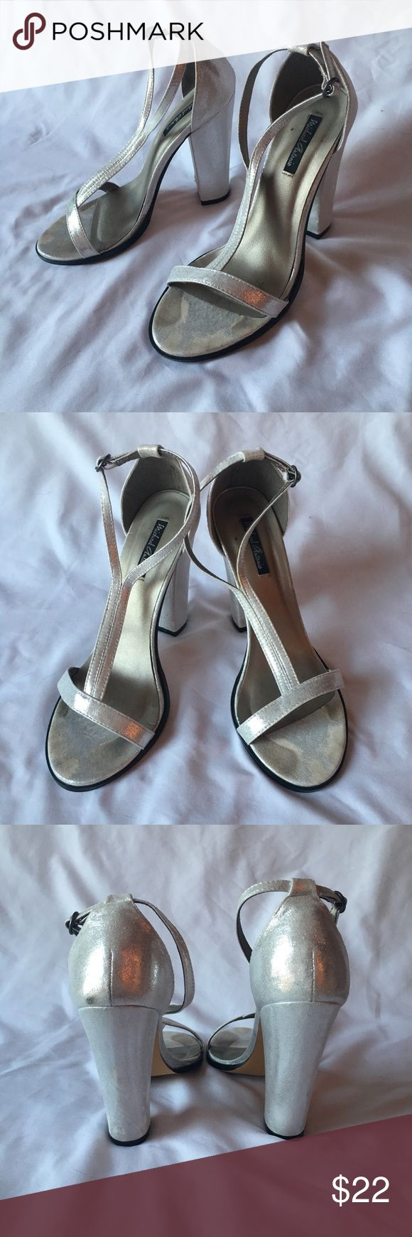 Michael Antonio Silver Strappy High-Heel Sandals Silver strappy high-heel sandals, size 8.5. 4.5-inch block heel, ankle strap.  Worn only once as a bridesmaid for a wedding. One small scuff on the back side of the right shoe  and a small tear in the material on the underside of the left heel (see third and fifth photos, respectively). Michael Antonio Shoes Heels