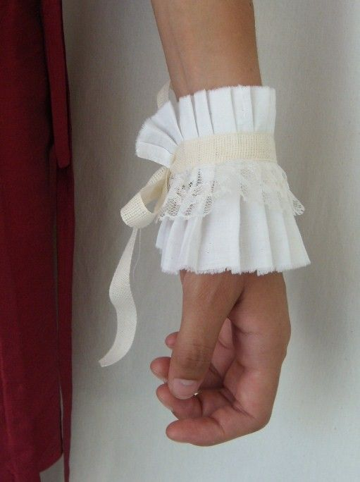 One Perfect Day is offering this lovely Champagne Ruffle Cuff wrist/armband accessory to one of you lucky ducks.This cuff is made almost entirely of vintage materials, the exception being the ribbon used to tie it around your wrist and even that has a vintage feel to it.The base of this cuff is made of pleated …