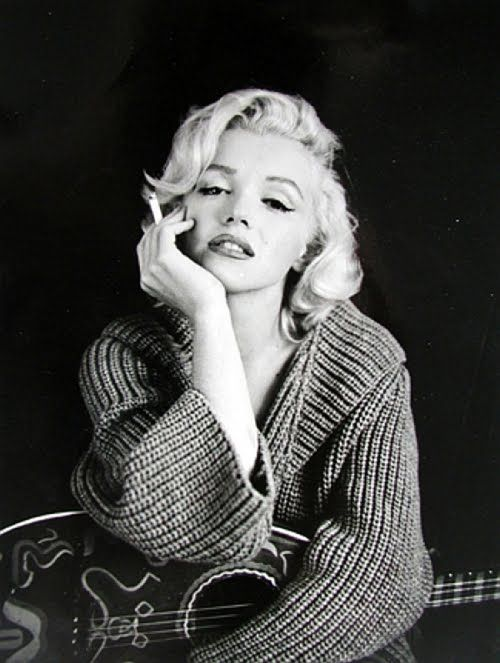 Monroe_Back when smoking was cool. Go figure. Yuck. Still...she never took a bad picture.