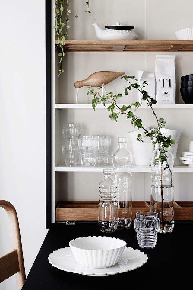 Shelves in the dining area of a beautiful and smart tiny one room flat in Finland