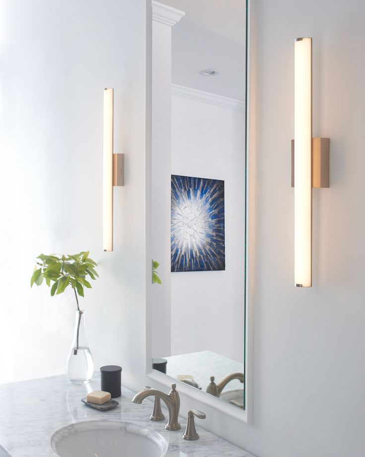 The sleek domed acrylic diffusor of the finn bath vanity light from tech lighting discreetly softens