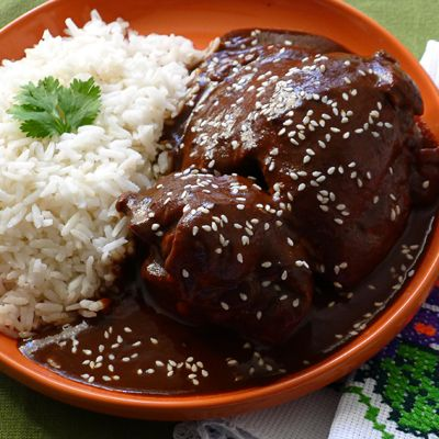 Slow Cooker Chicken Mole | Meals.com -  This version of Chicken Mole, a traditional Mexican dish, is prepared in a slow cooker to allow the complex flavors to fully unite. Serve with hot, cooked rice. #mexicanrecipes #chickenmole