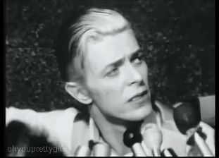 bowieakajohn:     meemalee:      David Bowie being interviewed after his arrest with Iggy Pop for marijuana possession in Rochester, NY.     This then led to The Most Beautiful Mugshot in the World™.           Always reblog the most beautiful mugshot in the world for good luck