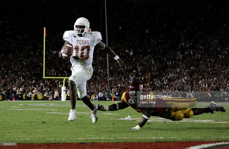 Vince Young #10 of the Texas Longhorns runs past Frostee Rucker #90 of the USC Trojans to score a touchdown and put the Longhorns up by one in the final moments of the BCS National Championship Rose Bowl Game at the Rose Bowl on January 4, 2006 in Pasadena, California.