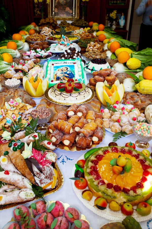 The feast of Saint Guiseppe (St. Joseph) in Sclafani Bagni, a region in Sicily.  Food altars prepared for poor children in the village.