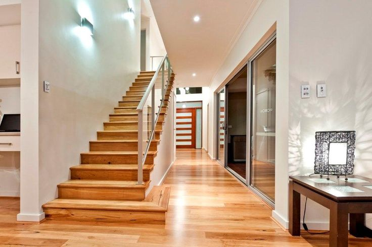 A beautiful staircase (concrete with timber flooring). The stair wall is on an angle to make the living area wider than the entry area - it really opens up the home visually as you walk in from the front door.