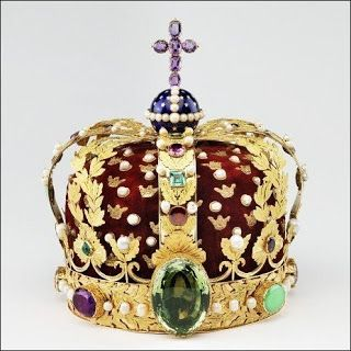 Norwegian Crown Jewels: The King's Crown - 1818 by goldsmith Olof Wihlborg. The crown is a corona clausa (closed model) consisting of a ring carrying eight hoops made of gold and surmounted by a globe of blue enamel and an amethyst cross on top of it. Its front is adorned with a huge green tourmaline, a gift of the Brazilian consul in Stockholm to King Charles III Johan.