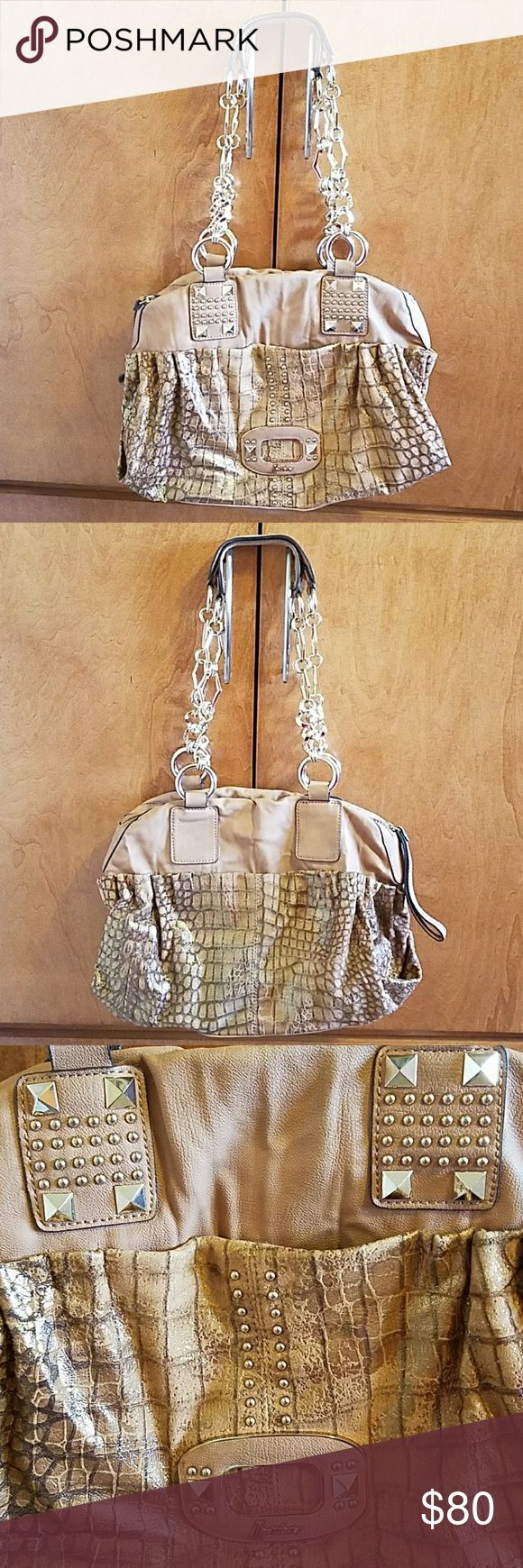 Guess by Marciano Bag Beautiful bag with goldtone hardware detail. Tan bag with distressed snakeskin look mixed with golden tones. Exterior magnetic closure pockets in the front and back. Clean interior has one zip pocket and one slip pocket. Strap hardware shows subtle signs of wear as shown in 5th photo. Also, some wear by the zipper as shown in 6th photo. Used only a few times. Dustbag included! Guess by Marciano Bags