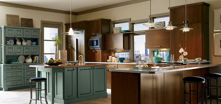 I like the mix of cabinet styles blythe maple clove with for Kitchen cabinets 51