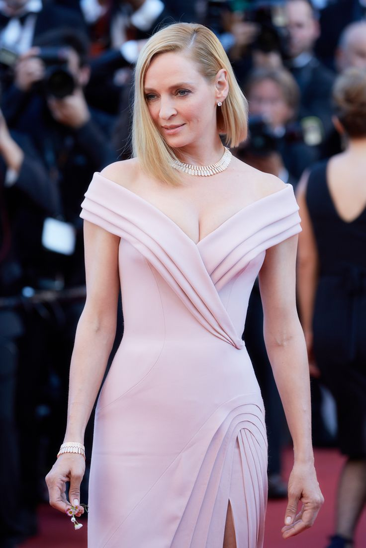 Uma Thurman wore Bulgari high jewellery Serpenti diamond necklace, matching bracelet and earrings to the opening night of the Cannes Film Festival, with a nude pink layered fold gown. For glamour celebrity fashion Cannes Film Festival red carpet jewellery spotting travel here: http://www.thejewelleryeditor.com/jewellery/top-5/cannes-film-festival-red-carpet-jewellery-day-one/ #jewelry