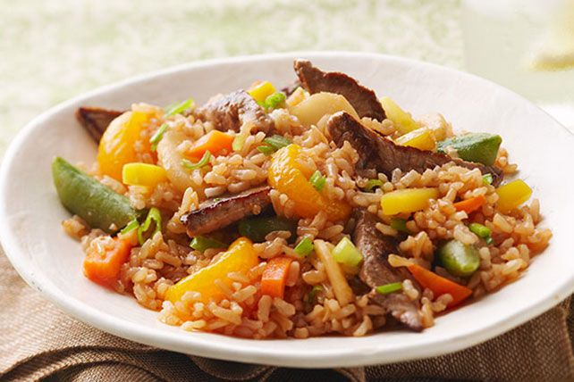 Ready to call for takeout? Stop! In just 20 minutes you can deliver your own amazing beef-and-veggie dish, with a sweet zing of oranges—and it's better for you.