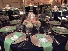 Mint and navy east coast wedding. Blush tones with white hydrangeas, navy colored thistle and gray dusty miller. Beautiful lantern centerpieces. Snowberrystudio.com #wedding