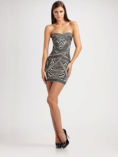 Eclectic criss-crossing of graphic patterns in a strapless mini style.