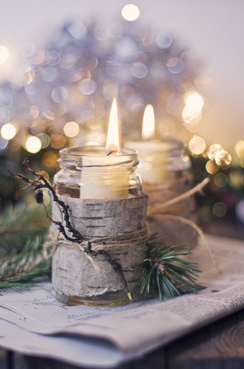Create a gorgeous woodland scene with natural evergreen branches, pinecones, twigs and other rustic decor like earthy candle holders homemade from mason jars.: