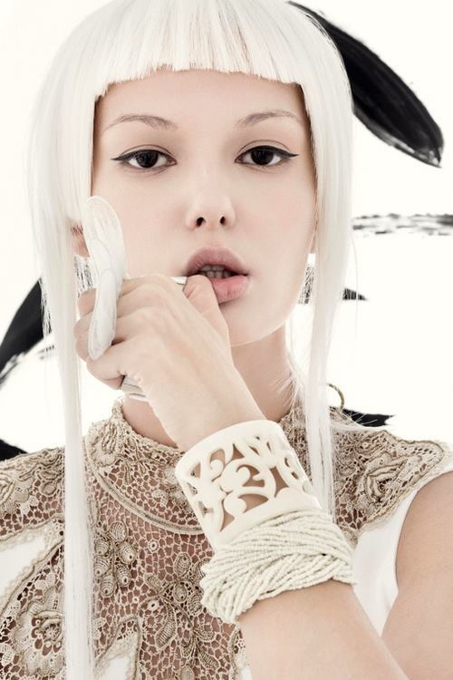 Asian editorial fashion photo.  Winter white hair, clothes and bracelet. Bijoux créteurs